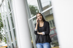 Young woman in front of office Stock Image