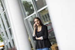 Young woman in front of office Stock Photography