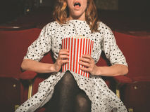 Young woman on front row of movie theater Royalty Free Stock Photos