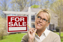 Young Woman in Front of Sold Sign and House Stock Photography