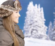 Young woman front of winter landscape smiling Stock Photos