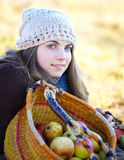 Young woman with fruit basket Royalty Free Stock Photography