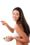 Young woman with fruit bowl. Stock Images