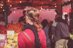 Young woman at fruit market Stock Photo