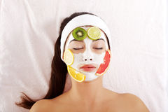 Young woman with fruit mask on a face Stock Photography