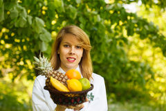 Young woman with fruit Stock Photography