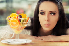 Young Woman with Fruit Salad Dessert Stock Photo