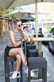 Young woman with fruit shake and smart phone. Stock Photos