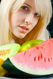 Young woman and fruits Stock Images