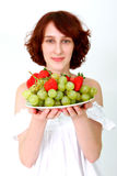 Young woman with fruits on a dish Royalty Free Stock Photography