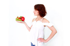 Young woman with fruits on a dish Royalty Free Stock Images