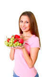 Young woman with fruits on a dish Stock Photo