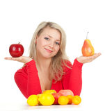 Young woman with fruits keeping apple and pear Royalty Free Stock Photography