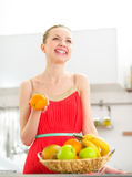 Young woman with fruits in kitchen Royalty Free Stock Photo