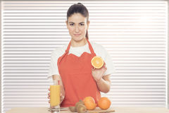 Young woman with fruits stock images
