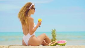 Young Woman with fruits Relaxing on the Beach. Young Woman with fruits Relaxing on the Beach stock video