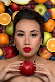 The young woman  with fruits smiles Stock Photo