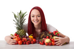 Young woman with fruits an vegetables. Young beautiful red haired woman with fruits an vegetables stock photos