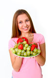 Young woman with fruits and vegetables on a dish Stock Image