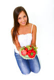 Young woman with fruits and vegetables on a dish Royalty Free Stock Photos