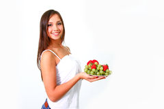 Young woman with fruits and vegetables on a dish Stock Photo
