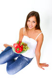 Young woman with fruits and vegetables on a dish Royalty Free Stock Image