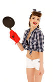 Young woman with frying pan. Stock Photography