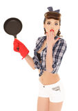 Young woman with frying pan. Royalty Free Stock Photo