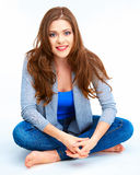 Young woman full body portrait. Beautiful smiling girl. Sitting on white floor Stock Image