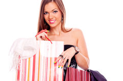 Young woman with full shopping bags Stock Photography