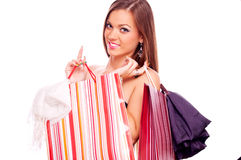 Young woman with full shopping bags Royalty Free Stock Photo