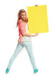Young woman with funky yellow sign Royalty Free Stock Photo
