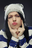 Young woman in funny winter hat Royalty Free Stock Images
