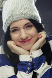 Young woman in funny winter hat. Playful young woman in funny winter hat Stock Image