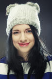 Young woman in funny winter hat. Playful young woman in funny winter hat Royalty Free Stock Photos