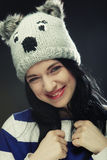 Young woman in funny winter hat Stock Photos