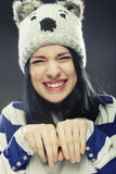 Young woman in funny winter hat. Playful young woman in funny winter hat Stock Photography