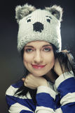 Young woman in funny winter hat. Playful young woman in funny winter hat Royalty Free Stock Image