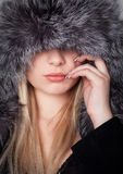 Young woman with a fur Royalty Free Stock Photography