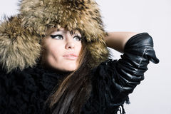 Young woman in a fur cap Stock Photo