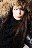 Young woman in a fur cap Royalty Free Stock Photography