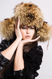 Young woman in a fur cap Stock Photography