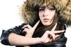 Young woman in a fur cap Stock Images