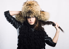 Young woman in a fur cap Stock Image