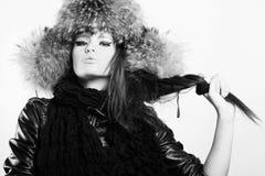 Young woman in a fur cap Stock Photos