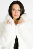 Young woman in fur coat Royalty Free Stock Images