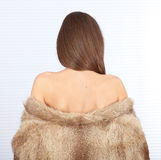 Young woman in a fur coat Stock Photo