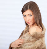 Young woman in a fur coat Royalty Free Stock Photo
