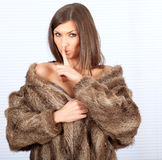 Young woman in a fur coat Royalty Free Stock Image
