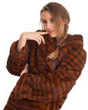 Young woman in a fur coat Royalty Free Stock Photos